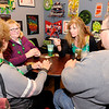 Don Knight | The Herald Bulletin<br /> Clockwise from left, Linda Grosswiler, Nicki Spence, Justine Hiles and David Spencer play a game of euchre during the St. Patrick's Day party at the Kettle Top Brewhouse on Saturday.