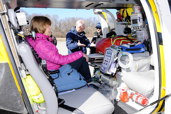 Don Knight | The Herald Bulletin<br /> Nancy McDonald sits in an air ambulance as Mike McDonald talks to air nurse Matt Klimas at Thursday's TRIAD meeting.