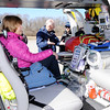 Don Knight | The Herald Bulletin<br /> Nancy McDonald sits in an air ambulance as Mike McDonald talks to air nurse Matt Klimas at Thursday's TRIAD meeting.