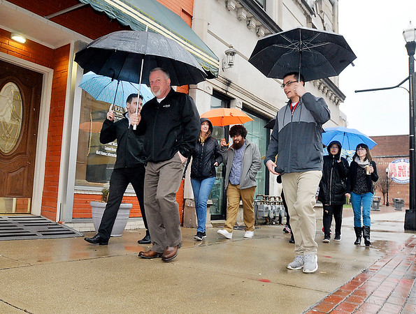 John P. Cleary   The Herald Bulletin<br /> Madison County Chamber & Anderson YMCA hosted the first Downtown Walk Around Thursday at noon. Here the group heads south along Meridian Street for their one mile walk through downtown.