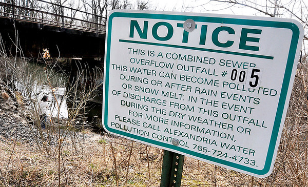 John P. Cleary | The Herald Bulletin<br /> This sign warning of possible polluted water is posted above this outfall on Pipe Creek near South Central and River Avenues in Alexandria.
