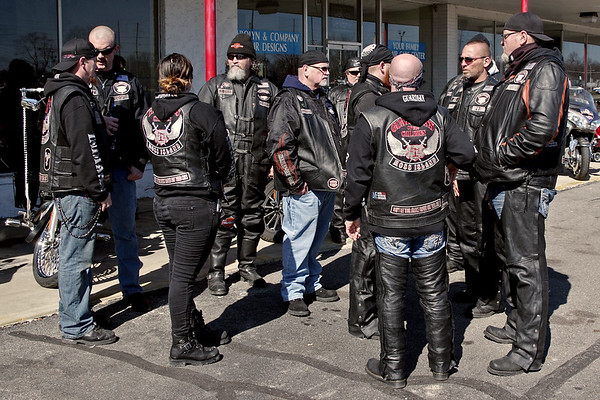 "Seargent of Arms Chuck Phillips (second from the right) discusses logistics with his fellow members of the Moss Island Chapter of the Guardians of the Children motorcycle club prior to the ""Justice for Harlan"" ride on Sunday."