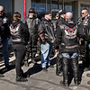 """Seargent of Arms Chuck Phillips (second from the right) discusses logistics with his fellow members of the Moss Island Chapter of the Guardians of the Children motorcycle club prior to the """"Justice for Harlan"""" ride on Sunday."""