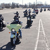 "The line of motorcyles starts rolling on the ""Justice for Harlan"" ride to raise funds to help the family of Harlan Haines pay his funeral expenses."