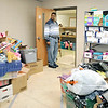 John P. Cleary | The Herald Bulletin<br /> Dove Harbor Administrative Director Tyrone Chandler checks one of the storage rooms that has children and baby items for clients needs.