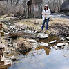 John P. Cleary | The Herald Bulletin<br /> Jennifer Ward looks over the old brick outfall that empties into Pipe Creek near South Central and River Avenues in Alexandria.