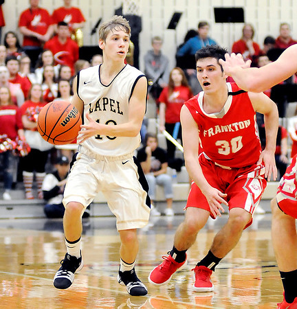 Don Knight   The Herald Bulletin<br /> Lapel's Carson Huber brings up the ball while being guarded by Frankton's Kayden Key during the Lapel 2A sectional championship game.