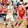Don Knight | The Herald Bulletin<br /> Lapel's Carson Huber brings up the ball while being guarded by Frankton's Kayden Key during the Lapel 2A sectional championship game.