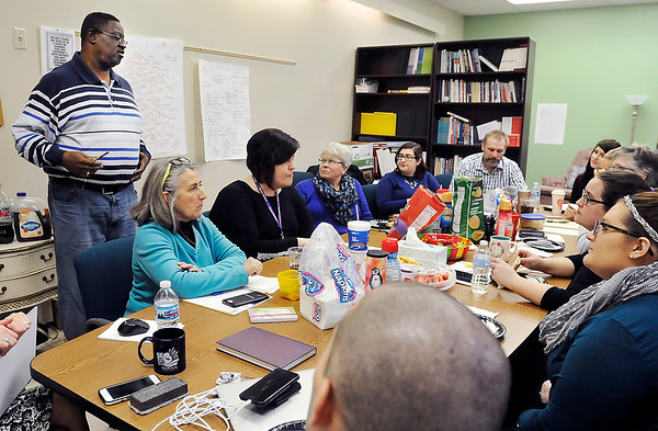John P. Cleary | The Herald Bulletin<br /> Administrative Director Tyrone Chandler talks to the Dove Harbor staff during a working lunch recently. Dove Harbor celebrating 25 years of service.