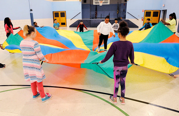 Don Knight | The Herald Bulletin<br /> Students play with a parachute during the Spring Break Youth Camp at the  Anderson Township Trustee Youth Center on Tuesday.