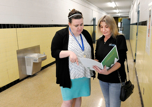 Don Knight   The Herald Bulletin<br /> APA Superintendent Jill Barker talks with Jan Smith of Ernie's Heart Pet Food Pantry, the first tenant in APA's new Leading Edge Center.