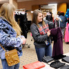 Don Knight | The Herald Bulletin<br /> Sydney Wagner, 17, finds a necklace to accessorize her prom dress as her gradmother Lori Wagner looks on during Anderson Public Library's Prom Dress Giveaway on Saturday.