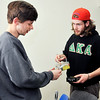 John P. Cleary | The Herald Bulletin<br /> Anderson University senior Logan Hauer heads up Operation Foundation, a team that does service projects and builds relationships with residents that live near AU.Anderson University senior Logan Hauer heads Operation Foundation. Here Hauer checks with AU sophomore Wes Busby, project  manager for Operation Foundation, on  what material is needed for their next project.