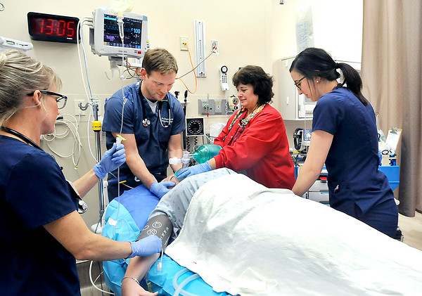 John P. Cleary | The Herald Bulletin<br /> Heather Hall, RN, Dr. Ben Ricke, Dawn Shreves, RT, and RN Carlie Morlock work on a patient in the trauma unit of Community Hospital's Emergency Department. Community Hospital Anderson has been verified a Level III Trama Center by the state of Indiana.