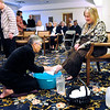 Don Knight   The Herald Bulletin<br /> Associate Pastor DonDeena Johnson washes the feet of Juanita Slattery during the Maundy Thursday service at Anderson First United Methodist Church. The service also included communion and was preceded by a meal.
