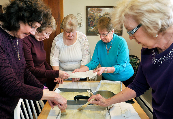 John P. Cleary | The Herald Bulletin<br /> Members of the Onward & Upward Homemaker's Club making baklava for the upcoming Homemaker's Day. Pictured are Traudi Flynn, MaryAnn Smith, Maribeth Flynn, Mary Bruns, and Mary Blake.