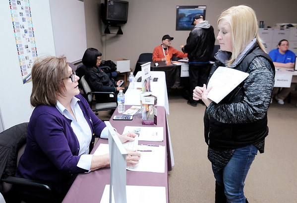 Don Knight | The Herald Bulletin<br /> Amy Coryell talks to Sharon Rhodes from Home Instead Senior Care during a regional hiring event hosted by WorkOne Central Indiana on Thursday. Home Instead serves residents of Madison and Delaware counties and is hiring caregivers.