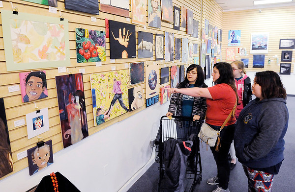 Don Knight   The Herald Bulletin<br /> From left, Amanda Turull, Genna Neeley, Kellie Ramsey and Alexis Mockler look a the Art Association of Madison County's 19th Annual Student Art Exhibit  at Mounds Mall on Wednesday.