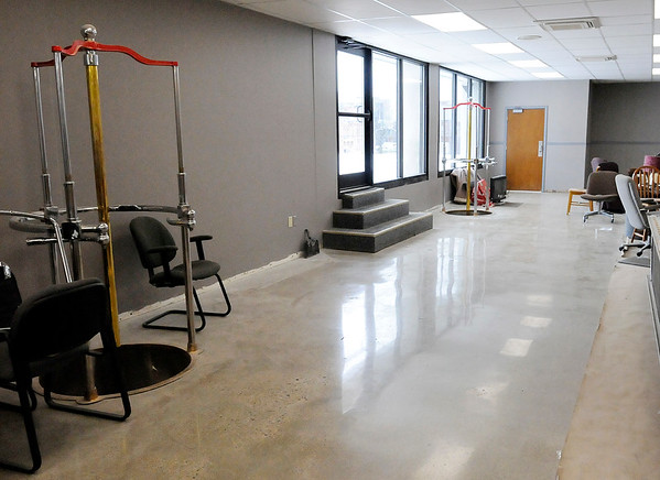 Don Knight | The Herald Bulletin<br /> To save money on the renovation of Anderson's Firestation 1 the concrete floor underneath old tile was polished instead of installing new tiles.