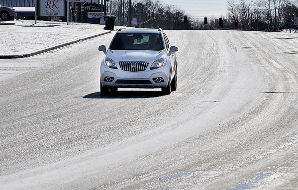 John P. Cleary | The Herald Bulletin<br /> Early morning snow busts caused roadways to become a glaze of ice like this stretch of Mounds Road along the 2100 block.