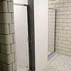 Don Knight | The Herald Bulletin<br /> The shower room at Firestation 1 has been redesigned for four individual shower stalls instead of one large room.