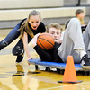Don Knight | The Herald Bulletin<br /> Bryce Carpenter rides through a slalom of traffic cones during a relay race during a pep rally for the Lapel Bulldogs on Friday ahead of the regional on Saturday. Lapel will face Oak Hill in the second game with a tip of approximately noon. Covington will play Tipton in the first game at 10:30 a.m.