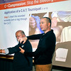 John P. Cleary   The Herald Bulletin<br /> Community Hospital Anderson RN Mark Rohlfing, right, shows the proper application of a tourniquet to the arm of Tom Bannon during a Stop The Bleed presentation to hospital staff members recently.