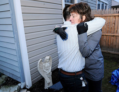 Don Knight | The Herald Bulletin Karl Lazar hugs Janice Campfield after the dedication of an angel garden in the memory of Campfield's daughter Brittni at the new Grace House on Wednesday. Grace House is an addiction recovery home for women.