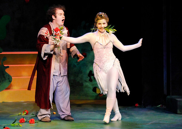 "Don Knight | The Herald Bulletin<br /> A husband, portrayed by Issac Derkach, feeds flowers to a unicorn, portrayed by Mackenzie McDaniel, in Boze Lyric Theatre's production of ""The Unicorn in the Garden"" at Anderson University."