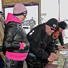"""Motorcyclists Jane Clark and Dave Hudson of Anderson register for the """"Justice for Harlan"""" fund-raising ride on Sunday."""