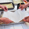 John P. Cleary | The Herald Bulletin<br /> Members of the Onward & Upward Homemaker's Club put another layer of phyllo dough over the filling as they build up the layers of the baklava.