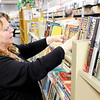 Don Knight   The Herald Bulletin<br /> Madison County Coalition Director Ginger Mills straitens books on the shelves at The Book Nook. The store raises funds for the Madison County Literacy Coalition and depends on book donations to stock their shelves.