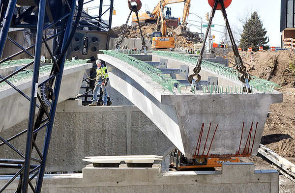 John P. Cleary | The Herald Bulletin<br /> The first beams for the new westbound lanes of Eisenhower Bridge were set in place Thursday. Workers from Primco Inc. will install three beam each day across the six spans of the new construction.