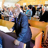 Don Knight | The Herald Bulletin<br /> John Henry King reads a responsive reading during a Good Friday Service at Church Upon the Rock on Friday. The service was held by the Concerned Ministers of Anderson and the Christian Clergy Association of Anderson.