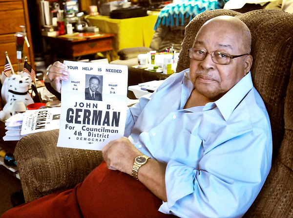 Don Knight / The Herald Bulletin<br /> In this Feb. 2014 THB file photo, John German holds one of his campaign posters that helped him get elected as the first African American member of the Anderson City Council in the fall 1975.