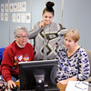 Don Knight | The Herald Bulletin<br /> From left, Peggy Hall, Monique Flores and Patti Sveum troubleshoot after having trouble filing an electronic return on Thursday. Computers and volunteers are available at the Impact Center Monday, Tuesday and Wednesday from 10 - 3 pm to help people file their tax return.
