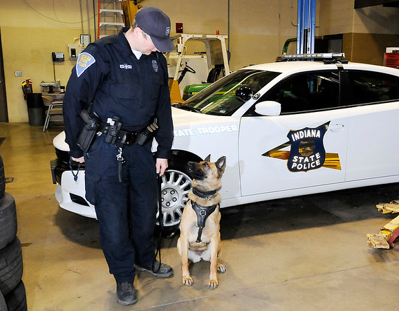 Don Knight | The Herald Bulletin<br /> Thomas Ratliff with his K9 partner Tora at the State Police Post in Pendleton on Tuesdasy. Tora will receive a bullet and stab proof vest thanks to a charitable donation.