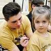Don Knight | The Herald Bulletin<br /> Luke Richardson signs an autograph for a young Bulldog fan during a pep rally for the Lapel Bulldogs on Friday ahead of the regional on Saturday.
