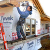 John P. Cleary | The Herald Bulletin<br /> AJ Custom Builders employees Scott Swinford and Chris Huff  work on this new residential construction in the South Main Village West addition Monday.