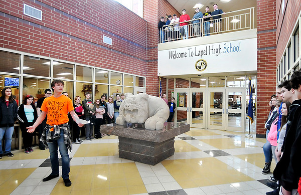 John P. Cleary | The Herald Bulletin<br /> Lapel High School junior Aidan Sturgeon speaks to fellow students that have gathered in the school vestibule Wednesday to participate in the national walkout protesting government inaction on gun control. After Sturgeons' comments the students observed 17 minutes of silence for the 17 victims of the Parkland, Fla. school shooting one month ago.