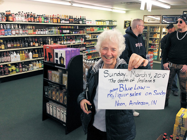 "Pat Sites shows off the sign she made so she could be photographed for a post on Facebook on Sunday at Save-On Liquor in Anderson. ""I just thought it was a big deal. We've had this law forever,"" she said. ""Maybe we'll get with the program and not live with the dark ages."""
