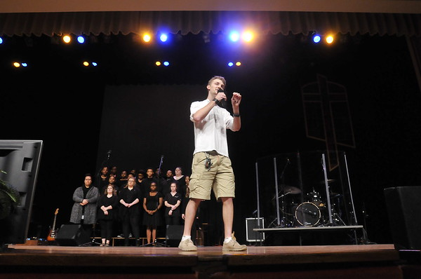 John P. Cleary | The Herald Bulletin<br /> Anderson University student Dominic Martin, recipient of the 2018 Nicholson Student Servant Leadership Award, speaks as a spoken word artist at AU's chapel service.