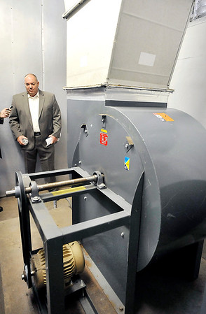 John P. Cleary   The Herald Bulletin<br /> Neal McKee, superintendent of the Anderson Water Department, checks one of the three air strippers that help remove volatile organic compounds found in the water.