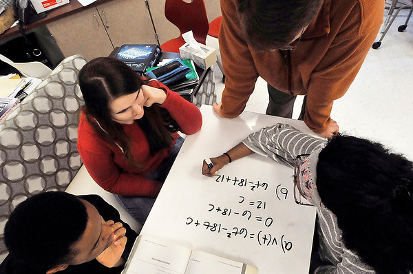 John P. Cleary | The Herald Bulletin<br /> Anderson High School math students Siraj Elbey, Marissa Merritt, math teacher Richard Ziuchovski, and Jai Jackson work on a calculus problem Tuesday during class using one of the new whiteboard tables.
