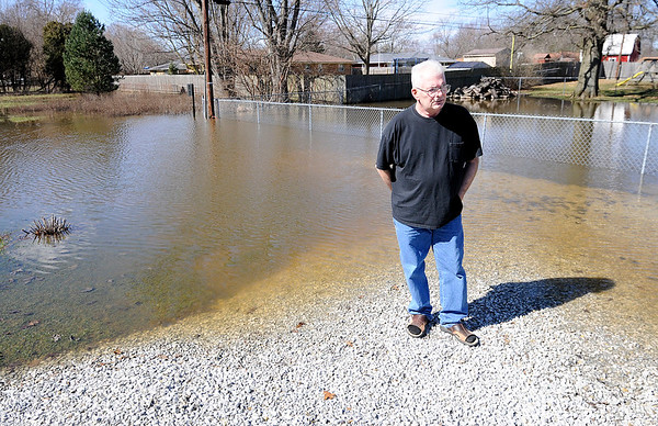 Don Knight | The Herald Bulletin<br /> Mike Murphy has brought in several loads of gravel to try and reclaim some of his back that is flooded most of the year due to a broken drain.