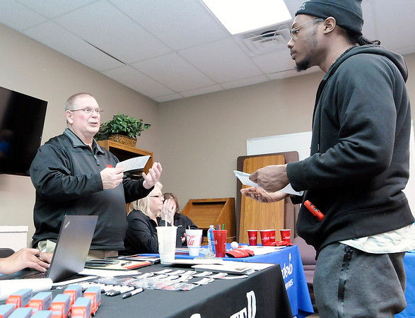 Don Knight | The Herald Bulletin<br /> David Goodwin talks to Carter Express Director of Recruiting Jim Fairfield during a regional hiring event hosted by WorkOne Central Indiana on Thursday.