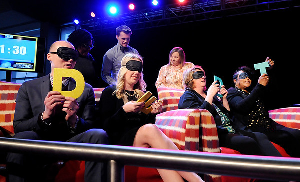 """Don Knight   The Herald Bulletin<br /> Jonathon Cook, Hayley Bramwell, Janice Marley and Sherry Peak-Davis spell out the word """"debt"""" while playing the game """"Four Letter Words"""" during United Way's awards dinner at Hoosier Park on Tuesday."""