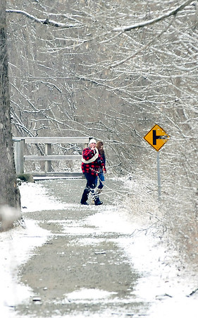 John P. Cleary | The Herald Bulletin<br /> These people walk the trails in Falls Park in Pendleton after a fresh snowfall blanketed the area Saturday afternoon.