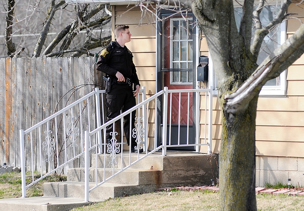 Don Knight | The Herald Bulletin<br /> John Vieke serves a warrant at a home in Anderson.