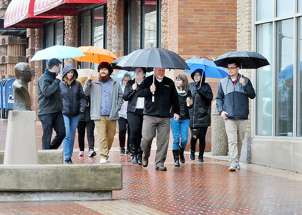 John P. Cleary   The Herald Bulletin<br /> Madison County Chamber & Anderson YMCA hosted the first Downtown Walk Around Thursday at noon. Here the group leaves the Chamber offices and heads south along Meridian Street for their one mile walk through downtown.